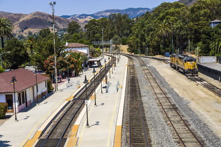 rebuild: SAN LUIS OBISPO, USA - JULY 28, 2008: train at the train station from San Luis Obispo, United States. The Amtrak rail station opened in 1895 and what rebuild in 1942 in spanish colonial revival style.
