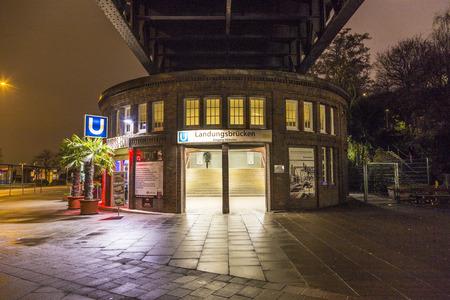build in: HAMBURG - GERMANY - DECEMBER 4: famous subway station Landungsbruecken by night on December 4, 2013 in Hamburg, Germany. The station was build in 1906 and is still in use. Editorial