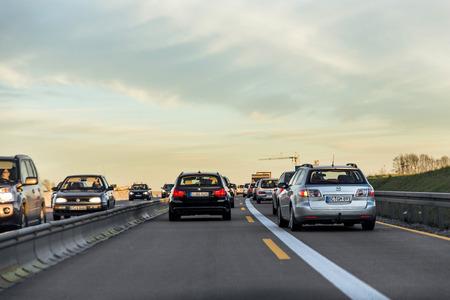autobahn: BURGAU, GERMANY - DEC 23, 2014: German highway  A8 with cars in sunset near Burgau, Germany. Bundesautobahn 8 (Federal Motorway 8)  is an autobahn in southern Germany that runs 497 km.