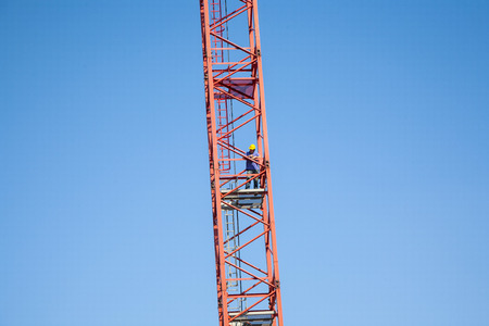 fulfilled: HOFHEIM, GERMANY - SEP 25, 2009: worker climbs a tall crane in Hofheim, Germany. Workers on construction sites are controlled oftwen by police to ensure that working safety is fulfilled according law. Editorial
