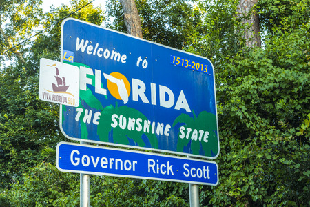 pensacola: PENSACOLA, FLORIDA - JULY 18, 2013: Welcome sign to the state of Florida in Pensicola, USA. The area is ruled by Governor Rick Scott.