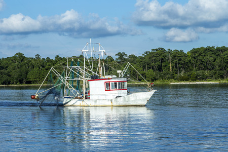 fisher: fisher boats get ready for night catch at Fairhope, USA. Fairhope is famous for the Alabama crab.