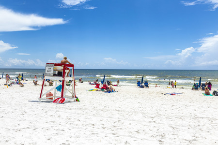 NICEVILLE, USA - JULY 21, 2013: people enjoy the beautiful beach at Niceville, USA. The adjacent cities of Niceville and Valparaiso, both built around Boggy Bayou, are known as the Twin Cities. Editorial