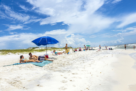 bayou: NICEVILLE, USA - JULY 21, 2013: people enjoy the beautiful beach at Niceville, USA. The adjacent cities of Niceville and Valparaiso, both built around Boggy Bayou, are known as the Twin Cities. Editorial