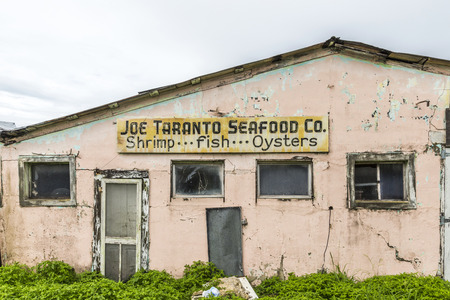famous industries: APALACHICOLA, USA - JULY 22, 2013: old fishery canning factory in Apalachicola, USA. More than 90 percent of Floridas oyster production is harvested from Apalachicola Bay. Editorial