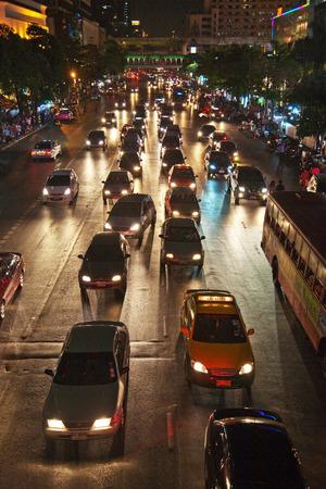 BANGKOK, THAILAND - MAY 6, 2009: heavy traffic at Main Road at night in Bangkok, Thailand. As of 2009 figures the outstanding number of vehicles in Greater Bangkok stood at greater 5 Mio.