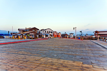 ranked: SANTA BARBARA, USA - JULY 28, 2008: people visiting scenic pier in sunset  in Santa Barbara, USA. First built in 1872, the wharf ranked as the longest deep-water pier. Editorial
