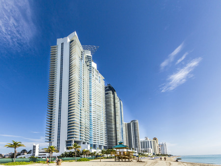 magnate: SUNNY ISLES BEACH, USA - JULY 28, 2013: people relax near the pier in Sunny Isles Beach, USA. In 1936, Milwaukee malt magnate Kurtis built Sunny Isles beach and pier. Editorial