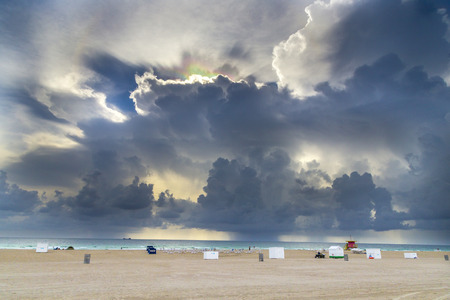 refracted: light refractions in the dark clouds at south beach in Miami