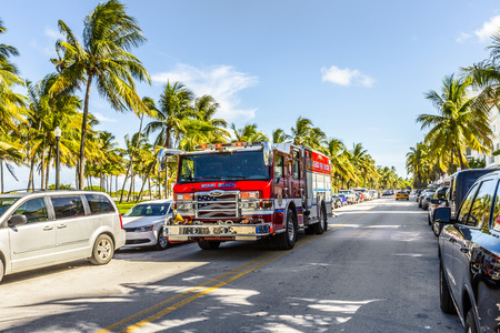 light duty: MIAMI, USA - AUG 1, 2013: fire brigade on duty in South Beach in Miami, USA. They are responsible for Fire Suppression, pre fire plans medical incidents, Fire Rescue and ocean rescue including 29 lifeguard towers. Editorial