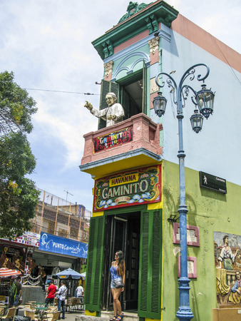 BUENOS AIRES, ARGENTINA - JAN 26, 2015: people visit Caminito Street in La Boca, Buenos Aires, Argentina. Caminito is a traditional alley, located in La Boca.