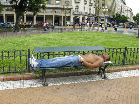 unemployment rate: BUENOS AIRES, ARGENTINA, JAN 26, 2015: man sleeps on a bench in Buenos Aires, Argentina. The unemployment rate in Buenos Aires rose to 8,1 percent in 2015.