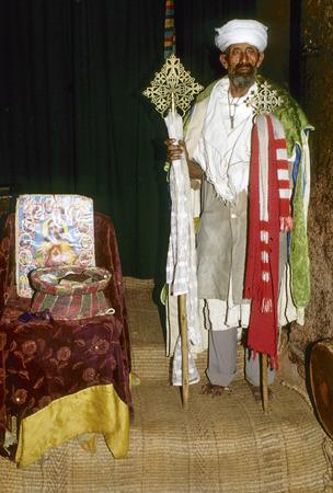 coptic orthodox: LALIBELA, ETHIOPIA - AUG 8, 2001: coptic priest is proud to present his church in Lalibela, Ethiopia. Editorial