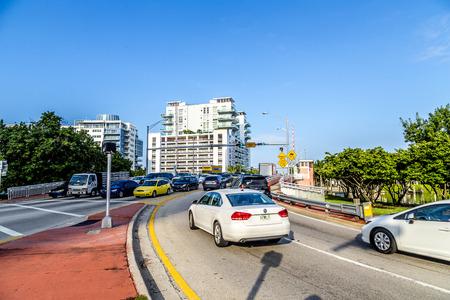 draw bridge: MIAMI, USA - AUG 6, 2013: cars cross the draw bridge in Miami, USA. The drawbridge belongs to the  Atlantic Intracoastal Waterway which guarantees a minimum overhead clearance of 56 feet. Editorial
