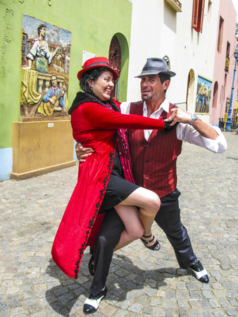 argentine: BUENOS AIRES, ARGENTINA - JAN 26, 2015: tango dancer pose for tourists in Caminito Street, Buenos Aires, Argentina. Caminito is a traditional alley, located in La Boca.