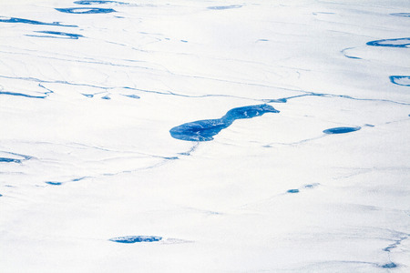 aerial of icy landscape in Alaska seen from aircraft