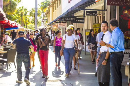 epicenter: MIAMI, USA - AUG 1, 2013: people go shopping in the afternoon sun in Lincoln Road, Miami, USA. Lincoln Road Mall is a pedestrian-only promenade and the epicenter of whats happening in South Beach. Editorial