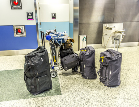 unattended: MIAMI, USA - AUGUST 7, 2013: unattended baggage at Miami international Airport in Miami, USA. Unattended baggage is a risk because of potential terrorist attacs.