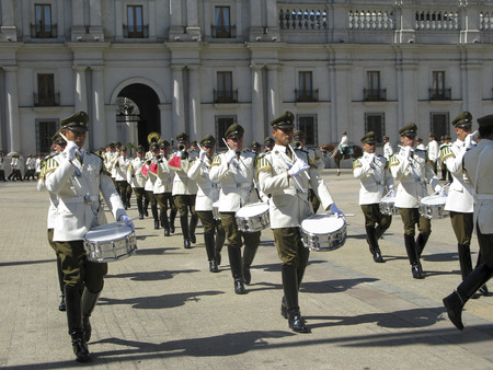 but: SANTIAGO, CHILE - JAN 25, 2015: ceremonial changing of the guard at Palacio de la Moneda in Santiago, Chile. The palace was opened in 1805 as a colonial mint, but later became the presidential palace.