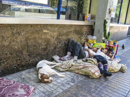 unemployment rate: SANTIAGO, CHILE - JAN 25, 2015: homeless people life and sleep on the road in Santiago, Chile. The Santiago unemployment rate rose to over 10 percent in March 2014.