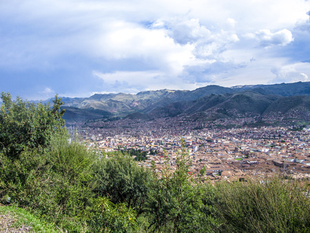 incan: view to old incan city of Cuzco with mountains of andes in background Stock Photo