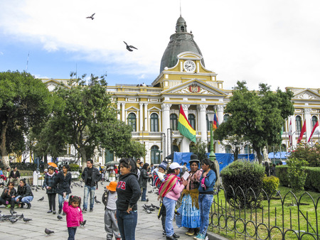 murillo: LA PAZ, BOLIVIA - JAN 21, 2015: people at legislative Palace, seat of the government since 1905, on Plaza Murillo in the city of La Paz, Bolivia.