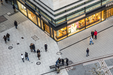 heart very: FRANKFURT, GERMANY - FEB 22, 2015: people walk along the Zeil in late afternoon in Frankfurt, Germany.  The Zeil is a very famous and old pedestrial zone in the heart of Frankfurt. Editorial