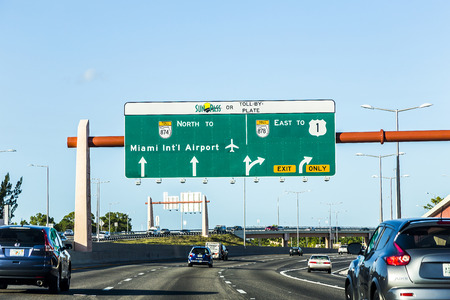deviation: MIAMI, USA - AUG 27, 2014: driving the Miami Highway from the airport direction East in Miami, USA. Sunpass lane on left hand side is for toll only. Editorial