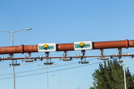 enables: MIAMI, USA - AUG 27, 2014: Sunpass lane at the Miami Highway in Miami, USA. Sunpass lane on left hand side is for toll only and enables electronical payment.