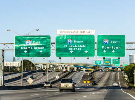 exit: MIAMI, USA - AUG 27, 2014: driving the Miami Highway from the airport direction East in Miami, USA. Sunpass lane on left hand side is for toll only. Editorial