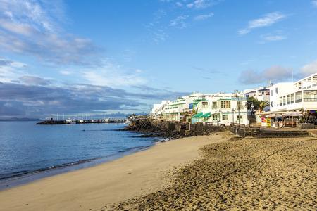 playa blanca: PLAYA BLANCA, SPAIN - NOV 12, 2014: early morning view to the promenade  in Playa Blanca, Spain. In 2010 around 10 thousand people lived in that former fishing village. Editorial