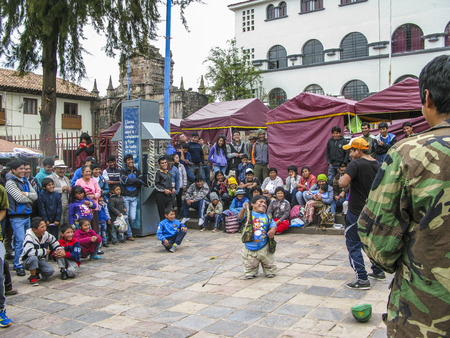begs: CUZCO, PERU - JAN 18, 2015: dwarf presents jokes to the audience and begs for an alm in Cuzco, Peru.