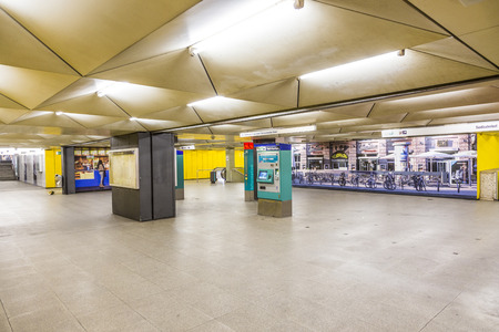 maschine: FRANKFURT, GERMANY - FEB 28, 2015:   metro station for S and U-Bahn Eschenheimer Turm in Frankfurt, Germany. The Metro station was inaugurated 1978 after 8 years under construction.