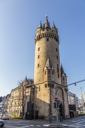 largely: FRANKFURT AM MAIN, GERMANY - FEBRUARY 28, 2015: Eschenheim Tower is the oldest and most unaltered building in the largely reconstructed new town of Frankfurt.