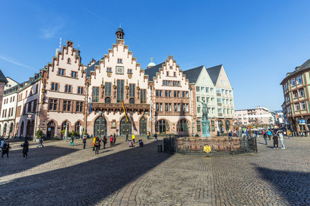 roemer: FRANKFURT, GERMANY - FEB 28, 2015: People on Roemerberg square in Frankfurt, Germany. Frankfurt is the fifth-largest city in Germany.
