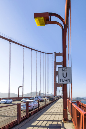 u turn sign: SAN FRANCISCO, USA - JULY 23, 2008:  pedestrian way at Golden Gate Bridge in San Francisco, USA with no U turn sign.