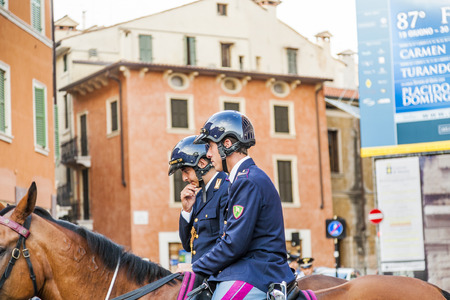 verdi: VERONA, ITALY - AUG 5, 2009: Police on horses are watching and helping the spectators entering the Arena di Verona for a Masterpiece of Verdi on  August 05,2009, Verona, Italy. Editorial