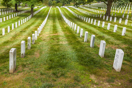 headstones: ARLINGTON, USA - JUL 15, 2010: Gravestones on Arlington National Cemetery  in Arlington, USA. Headstones mark soldier graves who died in every conflict from Revolution to Sept 11.
