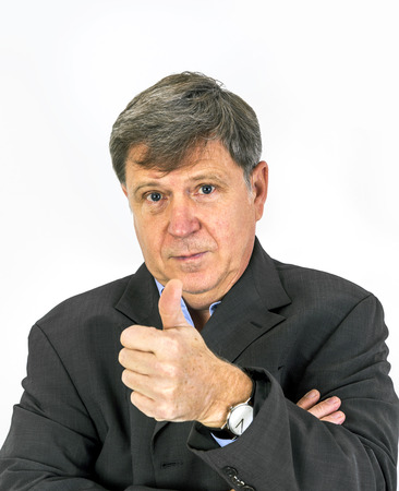 thumbs up sign: Portrait of business man showing thumbs up sign Stock Photo