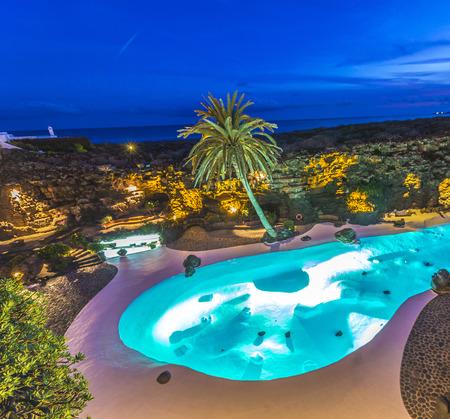 manrique: HARIA, SPAIN - NOV 13, 2014: swimming pool at Jameos del Agua in Haria, Spain in the evening. Artist Cesar Manrique built this place in 1966.