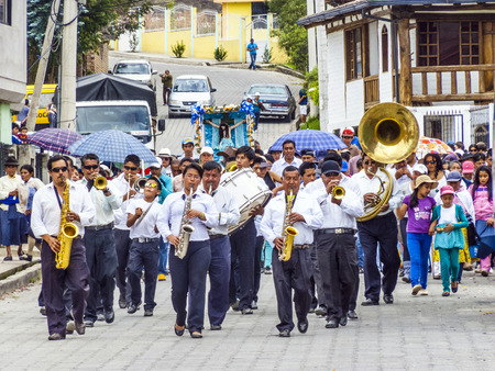 brass  band: VILLABAMBA, EQUADOR - MAY 11, 2014: Brass Band performs a religious parade in Villabamba, Equador. Brass bands are a local must for all cities in Equador.