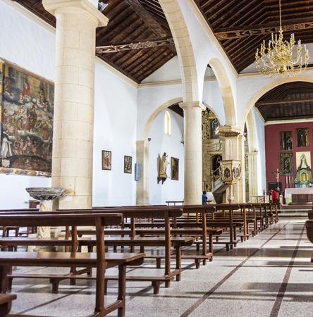 oliva: LA OLIVA, SPAIN - NOV 19, 2014: famous Church Fuerteventura in La Oliva, Spain.  Highlights inside the church is the mudejar ceiling, and a large painting of The Last Judgment. Editorial
