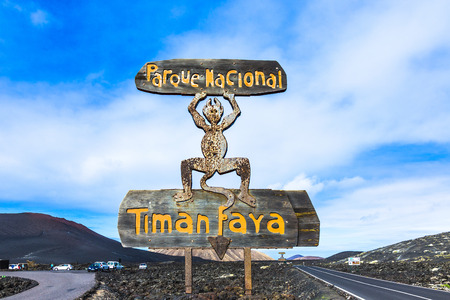 timanfaya: YAIZA, SPAIN - NOV 12, 2014: Devil sign by entrance Timanfaya National Park in Lanzarote in Yaiza, Spain. The devil sign was created by Cesar Manrique.