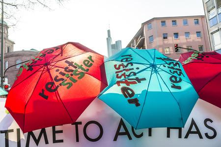 demonstrate: FRANKFURT, GERMANY - MAR 18, 2015: people demonstrate against EZB and Capitalism in Frankfurt, Germany. 30 tsd people demonstrate. They are holding banners.