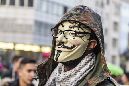 occupy: FRANKFURT, GERMANY - MAR 18, 2015: people demonstrate against EZB and Capitalism in Frankfurt, Germany. They wear the occupy mask as symbol