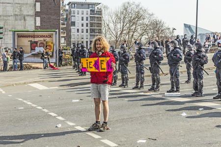 blockade: FRANKFURT, GERMANY - MAR 18, 2015: people demonstrate against EZB and Capitalism in Frankfurt, Germany. 30 tsd people demonstrate. They are holding banners.
