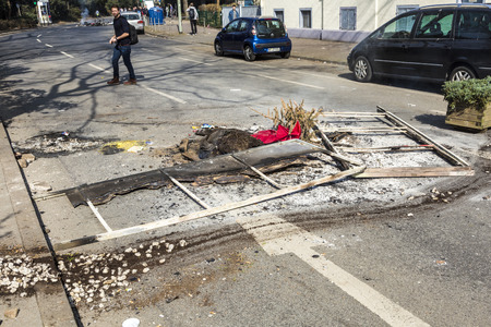 demonstrate: FRANKFURT, GERMANY - MAR 18, 2015: people demonstrate against EZB and Capitalism in Frankfurt, Germany. Some people destroy windows and objects at the street are burning.