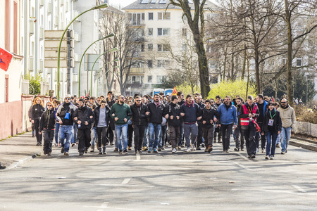 riots: FRANKFURT, GERMANY - MAR 18, 2015: people demonstrate against EZB and Capitalism in Frankfurt, Germany. 30 tsd. people join the demo.
