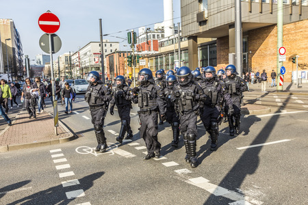 riots: FRANKFURT, GERMANY - MAR 18, 2015: people demonstrate against EZB and Capitalism in Frankfurt, Germany. 9 tsd policemen guard the demo.