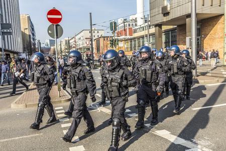 FRANKFURT, GERMANY - MAR 18, 2015: people demonstrate against EZB and Capitalism in Frankfurt, Germany. 9 tsd policemen guard the demo.
